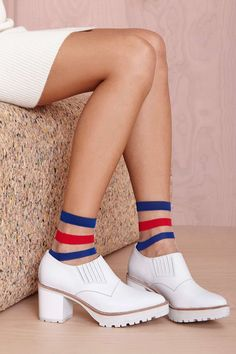 Get your game face on with these athletic-inspired mesh socks featuring blue and red stripes at top, a seamed toe, and stretch fabric.