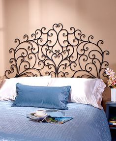 The Scrolled Wall-Mount Headboard is a easy decor solution for a bedroom with limited space. Just mount this elegant piece on the wall above the bed to create t