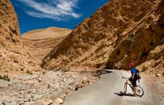 Biker in Todra Gorge, Morocco (© Francesco Ridolfi/Alamy)