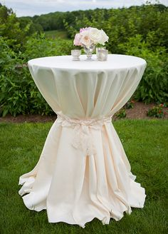 How cute is the idea of cinching a tablecloth with a lace bow!