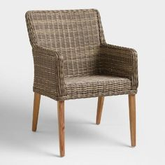 A low profile and mid-century-style legs give our armchair its on-trend appeal. Versatile enough to pair with nearly any of our dining tables, it features a lightweight aluminum frame with weather-resistant resin wicker in a multi-tone gray with highs and lows for added depth.