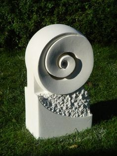 Spiral Koru sculpture - The koru is a symbol of creation because of its fluid circular shape. Based on the unfurling fern frond of the native New Zealand silver fern. Wellington | New Zealand