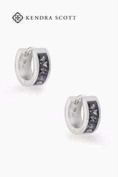 All about high shine that can be dressed up or down, the Jack Silver Huggie Earrings in Charcoal Gray Crystal is defined by its baguette crystals that nod to the Art Deco era.