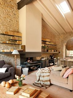 Home Design and Decor , Rustic Modern Interiors For The Homes : Rustic Modern Interiors With Stone Walls And Fireplace And Oversized Chair And Sofa And Wooden Coffee Table And Open Shelves And