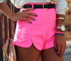 High waisted neon shorts, colorful accessories, blue mani.