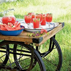 Alfresco Bar Cart | This outdoor bar offers colorful refreshments like a Honeysuckle Watermelon Cocktail and fresh watermelon slices. | SouthernLiving.com