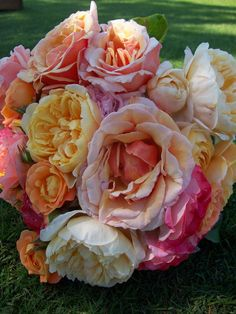From someone else's pinterest.... This may be what I do as well!    The bridesmaids bouquets will be pink-orange-pink garden roses, bright coral garden roses, pink lisianthus and green buds, yellow spray roses, and orange spray roses wrapped in ivory ribbon bows.