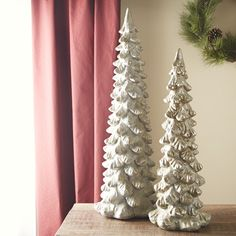 Pearlized Glass Tree | A generous dusting of silver sparkle brings a touch of winter elegance to any decor.