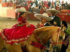 Last minute tips before competition. This child is about 5 yrs. old. and riding side saddle. These competitions are very important for the people of Jalisco. It is an expensive sport and people who are well to do usually compete against each other.