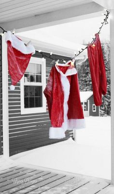 of The Season- A Holiday Home Tour Front porch idea! Hang a Christmas Santa Suit from a string of lights Outdoor Christmas decorationFront porch idea! Hang a Christmas Santa Suit from a string of lights Outdoor Christmas decoration Christmas Garden, Country Christmas, Winter Christmas, Christmas Home, Christmas Ornaments, Christmas Ideas, Merry Christmas, Christmas 2019, Hanging Christmas Lights