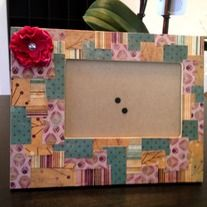 Gorgeous scrapbook picture frame with pink flower.