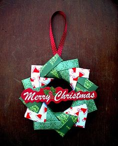 This Origami Wreath Tutorial is so easy that you'll want to make several for your home and family. Use paper to create 12 interlocking origami squares. Paper wreaths make wonderful holiday decorations because they are so cute and affordable to make. Origami Christmas Ornament, Handmade Christmas, Christmas Wreaths, Christmas Crafts, Christmas Decorations, Origami Ornaments, Wreath Crafts, Christmas Projects, Holiday Crafts