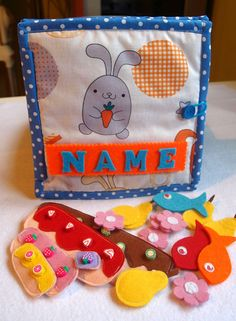 Check out this item in my Etsy shop https://www.etsy.com/listing/608238917/personalized-quiet-book-educational-toy