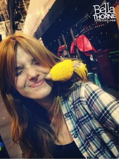 Bella Thorne with a parrot