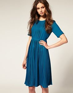 short sleeve high neck pleated midi dress.     I have a vintage dress in blue color as well and it looks like this. Awesome!