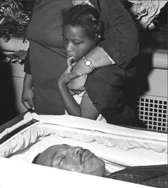 A photograph by Harry Benson of a young girl glancing at the body of Dr. Martin Luther King, Jr. who was assassinated on April 4, 1968. His funeral was held in Atlanta on April 9. The civil rights leader was only 39 years old.