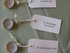 Oooh yes!  Place cards attached to tiny compasses.