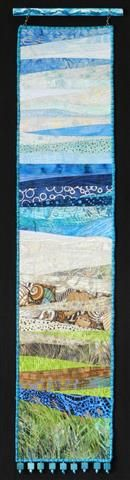 Sea Glass by Eileen Williams.  Small art quilt beach scene hanging from hand painted dowel.