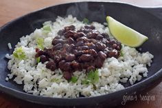 Cuban Style Black Beans Recipe Side Dishes with olive oil, onions, garlic, scallions, red bell pepper, cilantro, black beans, water, bay leaf, cumin, oregano, red wine vinegar, salt, black pepper
