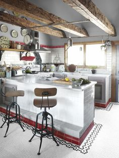 With the exception of the late-1700s beams, musician Neko Case started from scratch in this kitchen — transforming the space with custom cabinetry, counters of locally quarried Danby marble, and a refurbished 1950s stove. The floor tile is by Daltile; the stools came from Restoration Hardware.    Read more: Kitchen Designs - Pictures of Kitchen Designs and Decorating Ideas - Country Living