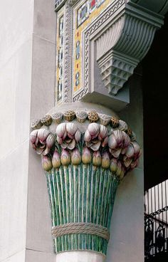 Tiffany's Daffodil Court ornamented column capitals in glass and terra cotta relief