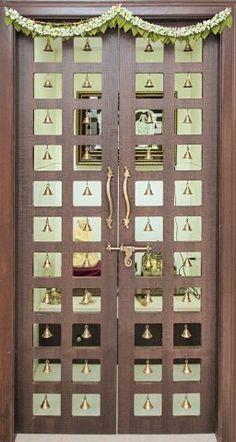 These Pooja Room Door Designs Are Simply Gorgeous! Simple pooja room door design with bells // modern pooja room bell design