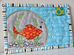 This is such a cute mug rug.  I love the idea of the appliqued fish, bubbles and especially the ribbon seaweed!