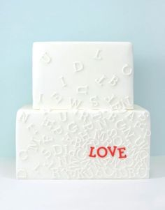 Such a cool idea for a contemporary wedding cake! For a twist, do your new last name in your wedding's color scheme!