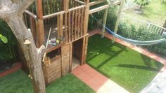 Cedar and cypress playhouse with artificial grass