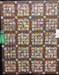 Scrappy Nine-Patch by Linda Simons.  Photo by Blooming in Chintz.  2014 Jacksonville Quilt Fest.