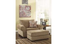 Large brown chair with foot rest for your living room décor