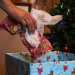 Managing the mess on Christmas morning - looks better than a garbage bag in photos