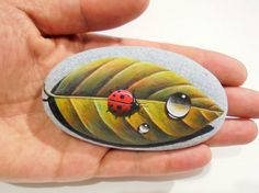Painted Stone Ladybug With Drop on a Leaf Is by KanetisStones