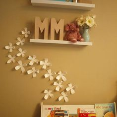 DIY wall flowers for above the headboard Would possibly be cool if you wrote on the paper before cutting the flowers out or figured out how to incorporate book pages