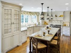 ... L-Shaped Kitchen Design Features Grey Granite Kitchen Countertop And Classic Black Three Pendant Lights With Pull Out Drawers Drawer Fronts And Pantry ...