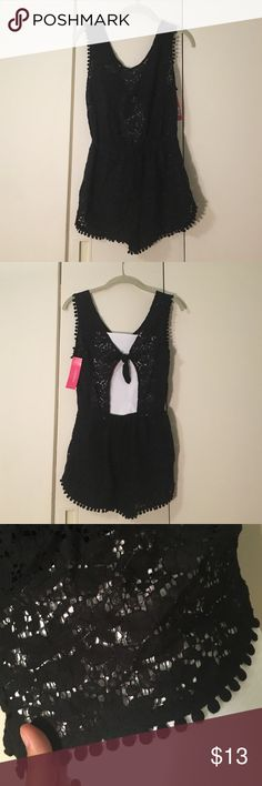 Black crochet coverup romper Xhilaration black crochet lace coverup romper. Completely see through and meant for the beach/pool!!!!! Has cute pompom style trimming and cutout on the back with a tie! Perfect for Summer!! New with tags! Xhilaration Swim Coverups