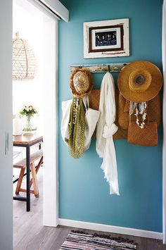 vibrant entryway with straw hats