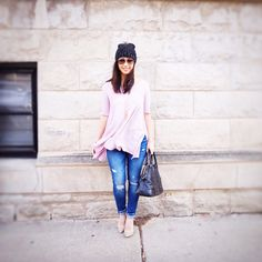 Pink top + distressed jeans + studded pumps