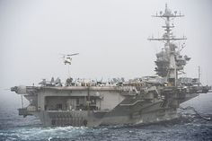 Aircraft carrier USS Harry S. Truman (CVN75) receives cargo during a vertical replenishment with dry cargo ship USNS Richard E. Byrd (T-AKE 4), not pictured.