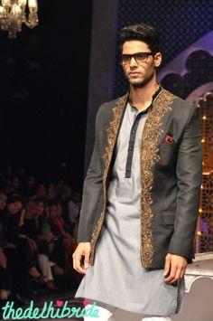 Raghavendra Rathore groom's wedding wear earthy tones on grey embroidery