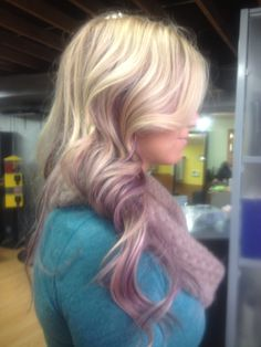 Professionally colored by Kendra! Amazing lavender highlights in platnium blond hair! Gorgeous!