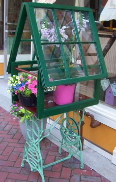 Industrial cottage terrarium constructed from an old sewing machine base and… Window Greenhouse, Small Greenhouse, Sewing Machines Best, Antique Sewing Machines, Vintage Windows, Old Windows, Window Frame Crafts, Vintage Sewing Table, Sewing Machine Tables