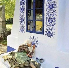 """Anežka Kašpárková is a grandma in her 80's who has been painting beautiful ultramarine blue flowers in her village for generations. She has painted many homes and even the inside and outside of the local chapel. The paint only lasts for a couple of years so Anežka is kept busy. She only ever uses this blue as she says it looks expensive an is of good quality."""