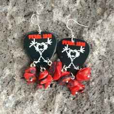 Pearl Jam guitar pick earrings made with coral.