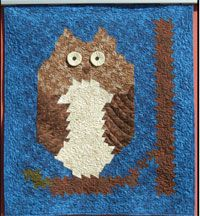 """Wise Old Twister Owl Quilt Pattern by Pohlar Fabrics at KayeWood.com uses the Primitive Pinwheels Twister tool to help create a fun owl quilt. Finished size is 37"""" x 42"""". http://www.kayewood.com/item/Wise_Old_Twister_Pattern/3161 $9.00"""
