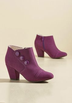 Sass Is in Session Bootie   Mod Retro Vintage Boots   ModCloth.com  Grab your notepads, because these purple booties from B.A.I.T. Footwear are here to serve up fierce lesson in footwear mastery! This pair's nubuck-inspired uppers kick off the lesson, followed by a trio of glossy buttons and angular heels for sartorial support. Your homework? Styling them your own way!
