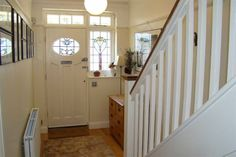 1930s door style & hallway...I would love this as a front door