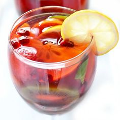 Christmas Sangria - easy festive holiday cocktail made with red wine brandy fruit and spices to sip in a cold winter night. Christmas Sangria, Holiday Cocktails, Winter Sangria, Winter Drinks, Sangria Recipes, Cocktail Recipes, Drink Recipes, Punch Recipes, Dinner Recipes