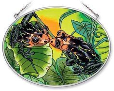 Amia 5526 Hand Painted Glass Suncatcher with Frog Design, 5-1/4-Inch by 7-Inch Oval by Amia. $19.00. Comes boxed, makes for a great gift. Handpainted glass. Includes chain. Amia glass is a top selling line of handpainted glass decor. Known for tying in rich colors and excellent designs, Amia has a full line of handpainted glass pieces to satisfy your decor needs. Items in the line range from suncatchers, window decor panels, vases, votives and much more.