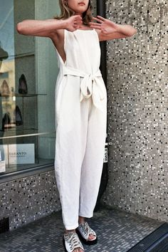 {White linen jumpsuit.}